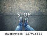 man standing on grunge asphalt... | Shutterstock . vector #627916586