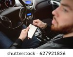 young man driving a car with an ... | Shutterstock . vector #627921836
