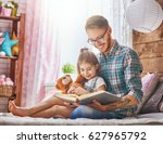 father and child on the bed in... | Shutterstock . vector #627965792