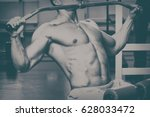 Small photo of A very strong man is engaged in the gym