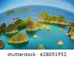 Small photo of Raja Ampat marine park, Blue Lagoon next to Painemo Island among small islands in the Indian ocean, in West Papua, Indonesia, Asia. planet Eath is a sphere concept.