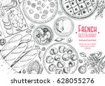 french cuisine top view frame.... | Shutterstock .eps vector #628055276