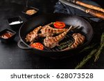 delicious fried lamb rack in a... | Shutterstock . vector #628073528