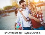 group of happy friends partying ... | Shutterstock . vector #628100456