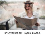 happy beautiful female tourist... | Shutterstock . vector #628116266