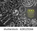 french cuisine top view frame.... | Shutterstock .eps vector #628125266