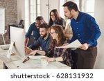 happy creative coworkers... | Shutterstock . vector #628131932