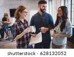 coworking colleagues having... | Shutterstock . vector #628132052