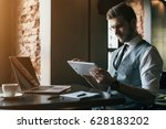 young handsome man working in... | Shutterstock . vector #628183202