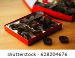 too mush sweets. empty box of... | Shutterstock . vector #628204676
