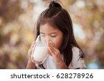 asian little girl is drinking a ...   Shutterstock . vector #628278926