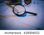 many charts and graphs with... | Shutterstock . vector #628306022