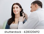attentive doctor doing ear exam ... | Shutterstock . vector #628320692