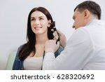 attentive doctor doing ear exam ...   Shutterstock . vector #628320692