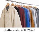 Small photo of men's different suit clothes ,coat, jacket ,coat,trousers, on hangers men's different suit clothes ,coat, jacket ,coat,trousers, on hangers