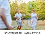 active seniors playing... | Shutterstock . vector #628359446