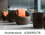 rattan chairs with pillows   Shutterstock . vector #628390178
