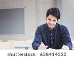 indian male student studying... | Shutterstock . vector #628414232
