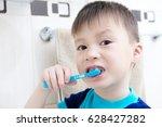 boy brushing teeth  child... | Shutterstock . vector #628427282
