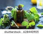 mint essential oil in bottle ... | Shutterstock . vector #628440905