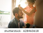 father and daughter plying at... | Shutterstock . vector #628463618