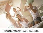 family having funny pillow... | Shutterstock . vector #628463636