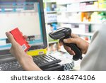 pharmacist scanning price on a... | Shutterstock . vector #628474106