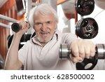 attractive senior man in gym... | Shutterstock . vector #628500002