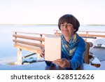 happy woman is sitting on the... | Shutterstock . vector #628512626
