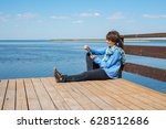 relaxing woman is sitting on a... | Shutterstock . vector #628512686