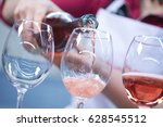 Stock photo glasses of rose wine from a bottle 628545512
