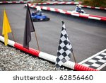 flags and cars on carting track | Shutterstock . vector #62856460