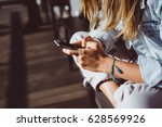 young cute woman using phone... | Shutterstock . vector #628569926