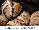 crusty loaves of artisan bread...   Shutterstock . vector #628572422
