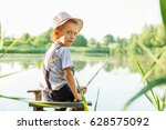 the boy is fishing  sitting on... | Shutterstock . vector #628575092