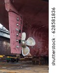 Small photo of Slavynka, Russia - April 21th, 2017: Port Slavynka, ship-repair factory, sea ship-repair dock with a vessel in it, the screw of a vessel and a wheel feather.