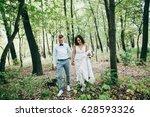 stunning wedding couple walking ... | Shutterstock . vector #628593326