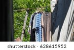 clothes in the sunshine | Shutterstock . vector #628615952