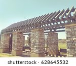 large stone pergola in city park | Shutterstock . vector #628645532