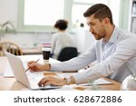 young man architect in office | Shutterstock . vector #628672886