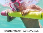 funny child wearing diver mask... | Shutterstock . vector #628697366