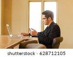 smart handsome asian... | Shutterstock . vector #628712105
