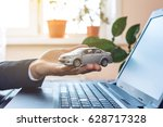 man in suit working with laptop ... | Shutterstock . vector #628717328