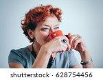 mature woman drinking coffee...   Shutterstock . vector #628754456