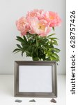 Small photo of Pewter finish metal photo frame mock-up with bouquet of peonies