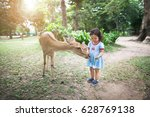 cute little girl playing with a ... | Shutterstock . vector #628769138
