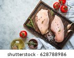 raw chicken fillet on cutting... | Shutterstock . vector #628788986