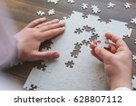the man puts puzzles in the... | Shutterstock . vector #628807112