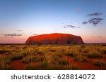 Small photo of ULURU, AUSTRALIA - CIRCA AUGUST 2016: Uluru after sunset on a clear winter evening, Uluru-Kata Tjuta National Park, Northern Territory, Australia