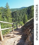 Small photo of Spring Hiking Trail at Eldorado Canyon State Park in Colorado #20 - descending with a guard rail on one side and a small rock drop down on the other